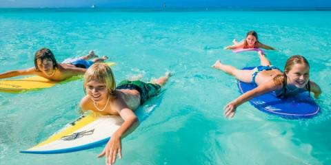 Kids learning to surf in the Caribbean
