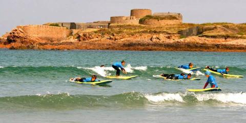 Surfing at Vazon Bay.