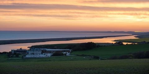 Sunset view over Moonfleet Manor and Chesil Beach.