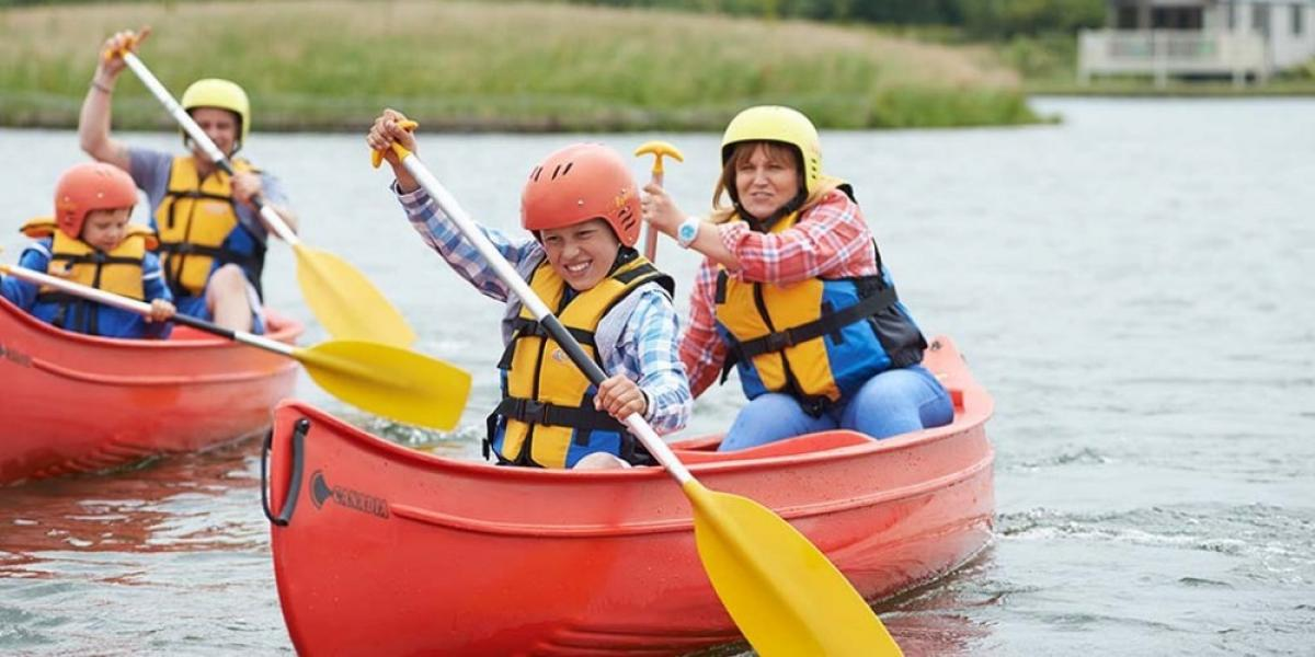 Family canoeing session at Haven Lakeland Leisure Park.