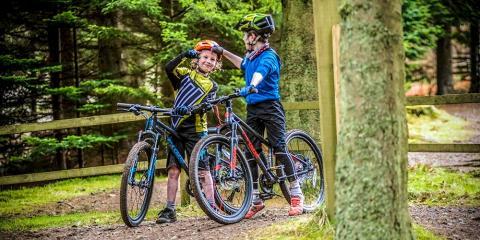 Kids enjoying Ridelines kids camps at Glentress in Scotland.