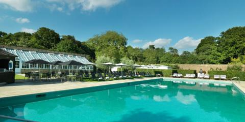 Relax by the pool and on the beach in the walled garden at The Grove Hotel.