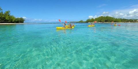 Kids kayaking at the Shandrani in Mauritius
