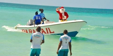 Santa arriving at Beaches Negril, Jamaica.