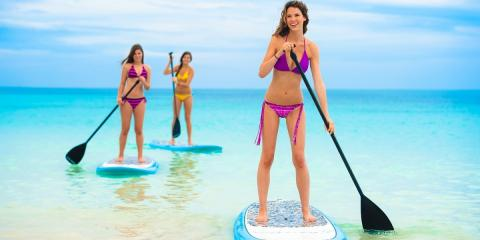 Paddle-boarding teens at Beaches Negril.