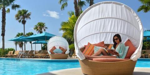 Relax around the pool at Fairmont Southampton, Bermuda.