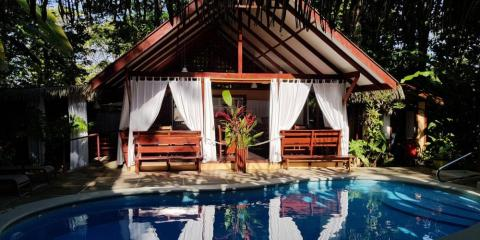 Chill by the rainforest-surrounded pool at Namuwoki Lodge.