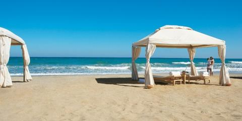Cabanas on the private beach at Grecotel Amirandes.