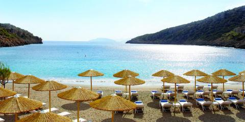 Private beach at Daios Cove Luxury Resort and Villas, Crete.