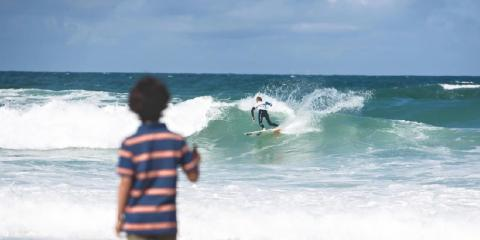 Take all the family to Newquay's Fistral Beach to learn to surf.