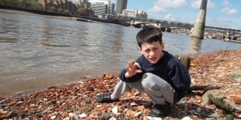 Dea's son on a Thames beach.