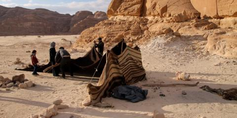 Setting up camp in the desert.
