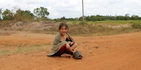 Arthur making a new friend in Sri Lanka.