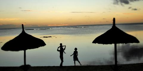 Family on a beach during sunset at a Club Med summer resort