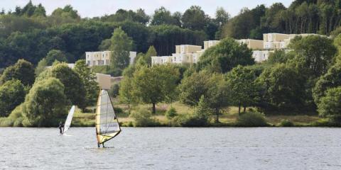 Windsurfing on lake at Center Parcs Europe Bostalsee Saarland.