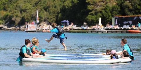 Fun in the sea with the kids' club crew at Retreat Beachclub, Greece.