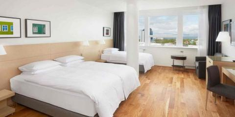 Family room with a city view at Hilton Reykjavik Nordica.