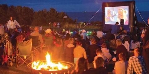Outdoor evening cinema at Whitecliff Bay.