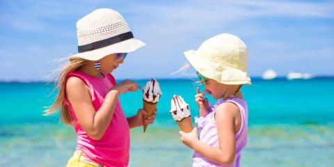 Kids eating ice cream on the beach