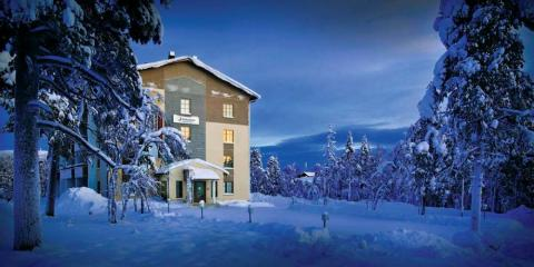 Snowy exterior of Hotel Snowflake and Apartments, Lapland.
