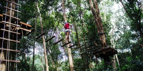 Walk in the jungle tree tops at Club Med Cherating Beach.