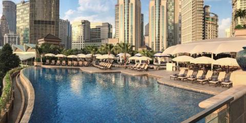 Infinity pool with city views at Mandarin Oriental Kuala Lumpur.