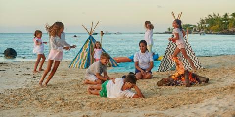 Kids' club evening beach activity at Royal Palm Beachcomber Luxury.