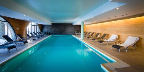 Stylish indoor pool at Kaya Chalet Hotel.