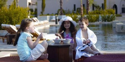 Kids by the pool at Four Seasons Marrakech.