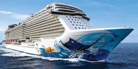 A huge cruiser sailing through a vibrant ocean