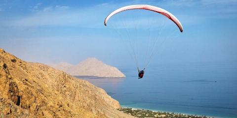 Paragliding over Zighy Bay with Six Senses.