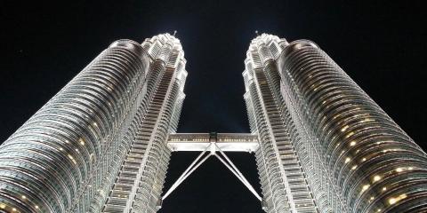 The Petronas Towers by night.