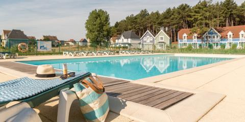 Poolside view at Pierre & Vacances Holiday Village Belle Dune.