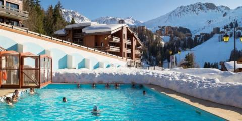 Heated outdoor pool at Pierre & Vacances Residence Plagne Lauze.