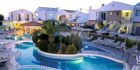 Pool at dusk at Pefki Islands Resort.