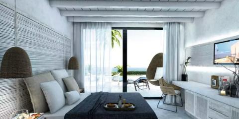 Stylish bedroom at TUI SENSATORI Atlantica Dreams Resort & Spa.
