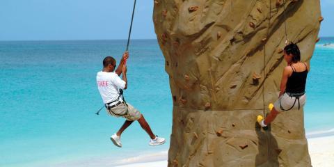 Climb the rockwall at Tamarijn Aruba.