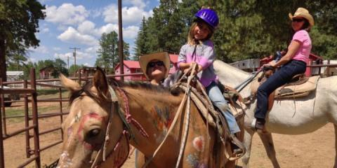 Learning to horse ride at Majestic Ranch, Colorado.