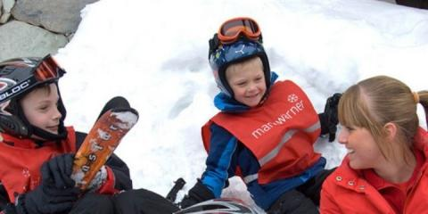Children playing in the snow with Mark Warner staff in Tignes.