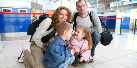 Family at airport check-in